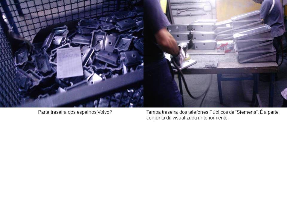 """Parte traseira dos espelhos Volvo?Tampa traseira dos telefones Públicos da """"Siemens"""". É a parte conjunta da visualizada anteriormente."""
