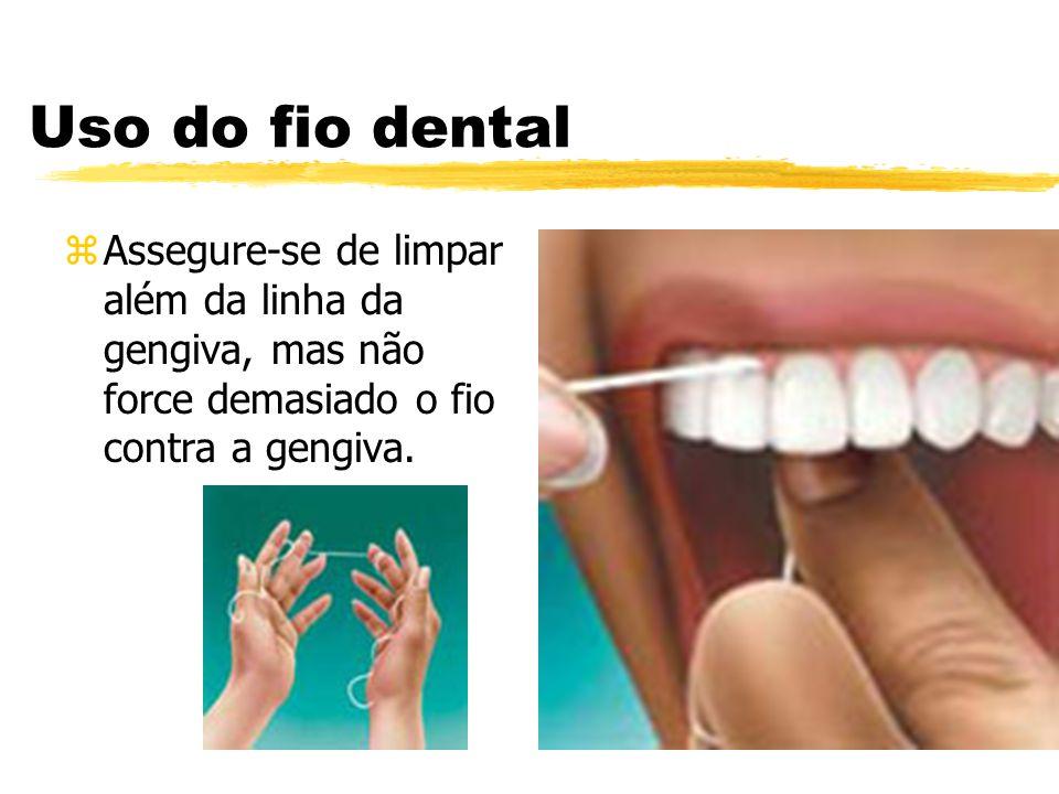 Uso do fio dental zAssegure-se de limpar além da linha da gengiva, mas não force demasiado o fio contra a gengiva.