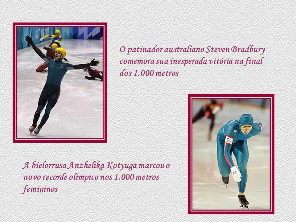 O patinador australiano Steven Bradbury comemora sua inesperada vitória na final dos 1.000 metros A bielorrusa Anzhelika Kotyuga marcou o novo recorde