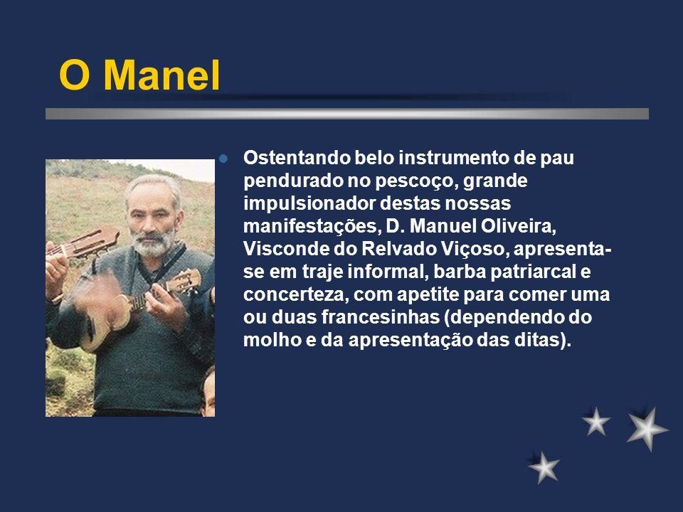 O Manel Ostentando belo instrumento de pau pendurado no pescoço, grande impulsionador destas nossas manifestações, D. Manuel Oliveira, Visconde do Rel