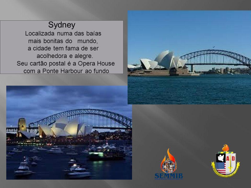 Sydney Localizada numa das baías mais bonitas do mundo, a cidade tem fama de ser acolhedora e alegre. Seu cartão postal é a Opera House com a Ponte Ha