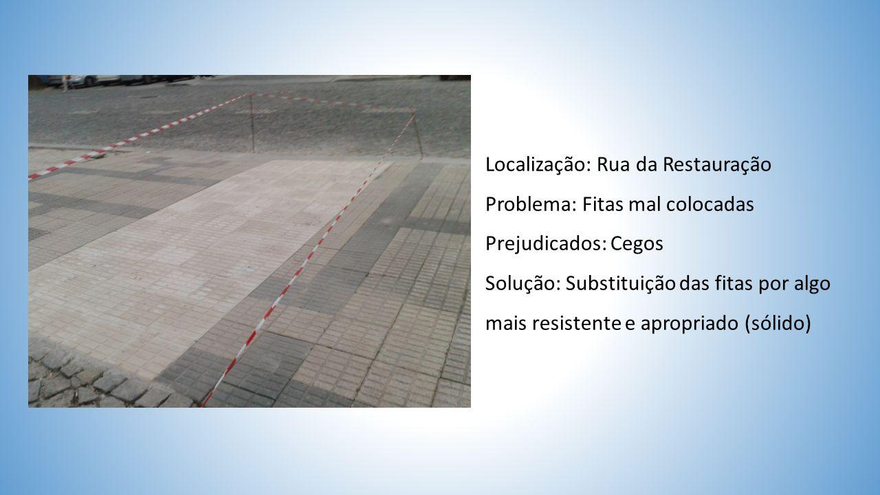 Localização: Rua da Restauração Problema: Fitas mal colocadas Prejudicados: Cegos Solução: Substituição das fitas por algo mais resistente e apropriado (sólido)