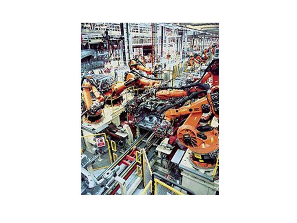 Sistemas Flexíveis de Manufatura (FMS) Componentes de um FMS: –Estações de trabalho NC (comando numérico): máquians ferramentas ou centros de trabalho automatizados –Instalações de carga/descarga (robôs) que movem peças entre as estações de trabalho –Instalações de transporte e manuseio de materiais entre estações ( esteiras, AGVs) –Sistema central de controlde por computador, que controla e coordena as atividades